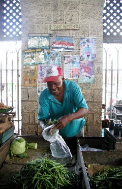 A trader in Mombasa, Kenya. Critics of East African economic integration say that Kenya is likely to reap the majority of the benefits.