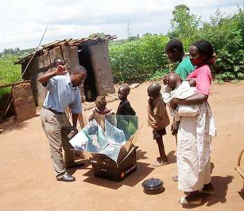 Mutebi demonstrating the solar oven in northern Uganda.