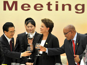 President of China Hu Jintao proposes a toast to South African President Zuma during the BRICS leaders meeting luncheon held at the Hilton Hotel in Sanya, China.