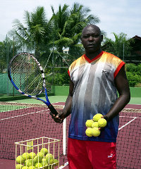 Antoine is a tennis instructor in Libreville, Gabon. Photo: Philippe Sibelly