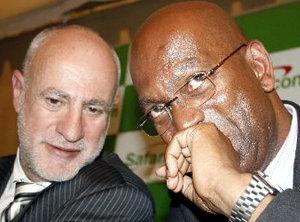 Bob Collymore (right) in discussion with former Safaricom CEO Michael Joseph.