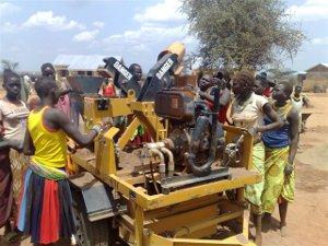 Workers in Uganda receive training on using Hydraform's brickmaking machine.