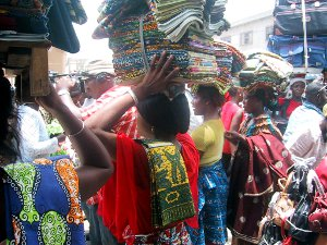 Women selling wax print textiles at a market in Togo.