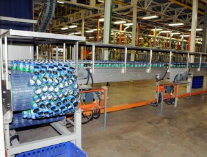 Sprite cans on a conveyer belt at Bevcan's manufacturing plant in Angola.