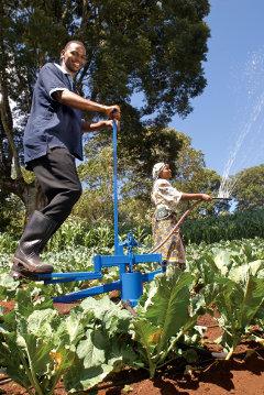 A smallholder farmer demonstrating KickStart's irrigation pump.