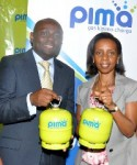 Michael Momanyi, general manager of Premier Gas, and Aida Kimemia, Principal Investment Officer at the IFC.