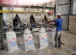 Bagging the processed cassava flour at Thai Farm's factory 120 km outside Lagos.