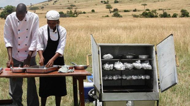 Preparing food with a Cookswell Jiko charcoal oven on a bush safari.