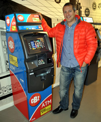 Marc Sternberg, managing director of Spark ATM Systems, with one of their new ATMs for the Zimababwean market, in partnership with CBZ Bank Limited.