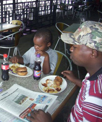 A family eating at a Steers branch in Kenya.