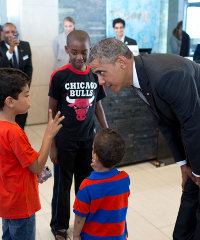 Obama greets young hotel guests in Dakar, Senegal.
