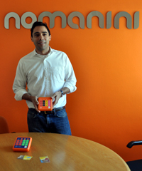 Vahid Monadjem with Nomanini's portable prepaid airtime device.