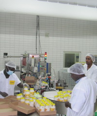 Workers pack bottles of mayonnaise at Nurevas's plant in Accra, Ghana.