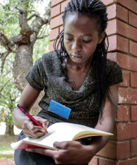 Laetitia Mukungu of Kenya, an Anzisha Prize Fellow , takes notes during the event.
