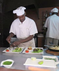 Chefs prepare a meal at the open kitchen of restaurant Le Toukouleur in the heart of Dakar city.