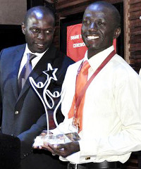 In 2012 Andrew Mupuya (right) won first place and US$30,000 in the Anzisha Prize youth entrepreneurship competition.