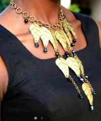 A model wearing a Riri Jewellery necklace