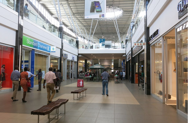 Zambia's shopping malls house international brands such as Guess and Levi's
