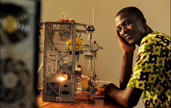 Togolese inventor Kodjo Afate Gnikou creating a 3D printer from recycled material for less than US$100 in 2013.