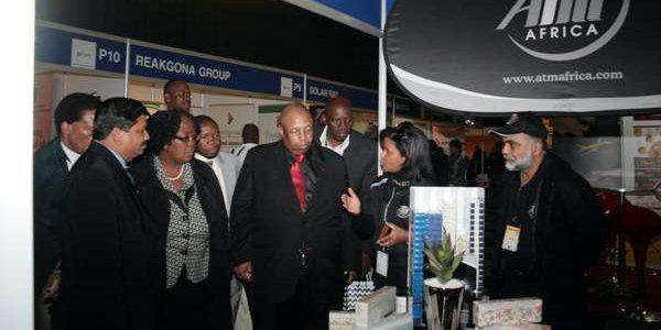 The City of Joburg's Reginald Pholo (third from right) visits one of the CoJ Pavilion exhibitors at SAITEX 2014.