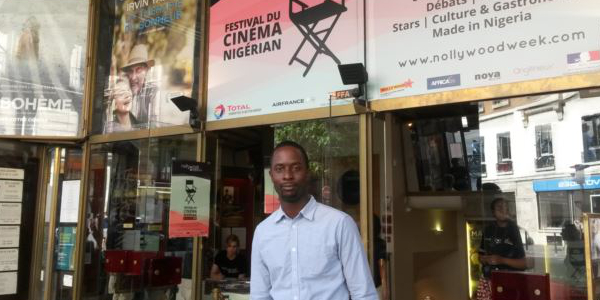 Festival organiser Serge Noukoue in front of the Paris cinema airing the Nollywood Week film festival. Photo by Lisa Bryant / VOA