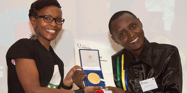 Dr Askwar Hilonga accepts the first Africa Prize for Engineering Innovation, handed over by Juliana Rotich, co-founder and executive director of Ushahidi.