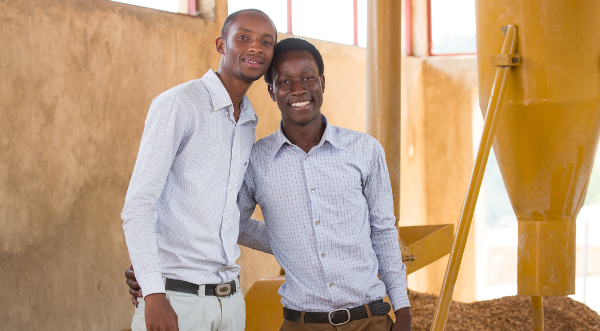 Jean Bosco Nzeyimana (right) and his company's waste crunching machine