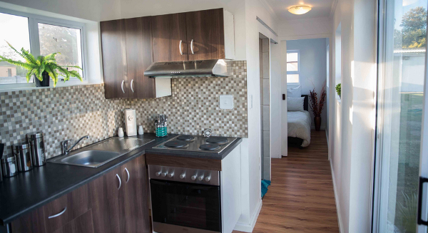 A vie inside a two bedroom container home which comes fully-fitted with features that such as oven, extractor fan and built-in cupboards. It costs R180,000 ($14,250).