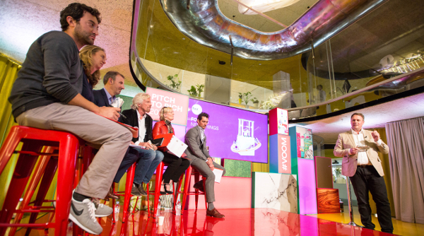 Jeff Paterson pitching to a panel of judges, including Richard Branson, at the 'Pitch to Rich' competition.