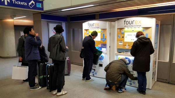 Two Fourex kiosks situated in King's Cross Station in London. It is estimated that there is about £3.2bn of unused, foreign coins in the UK alone, and this is increasing by around £900m a year.