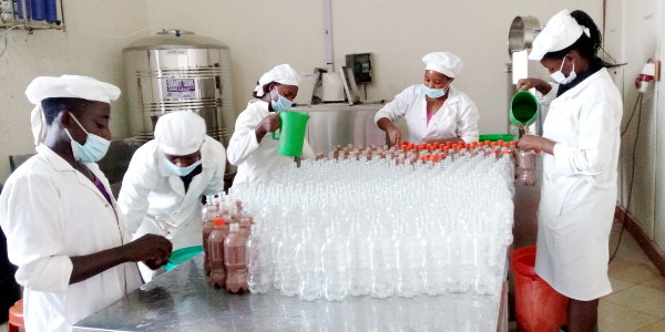Employees filling bottles at the company's plant.