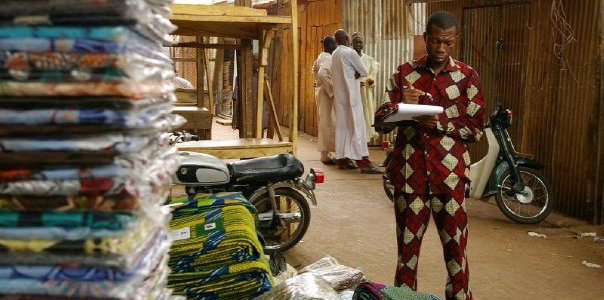 Wax print fabrics for sale at a market in Sokoto State, Nigeria.