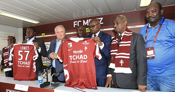 FC Metz president, Bernard Serin, and Betel Miarom, minister of culture, youth, and sport, reveal the new FC Metz jersey in late August.