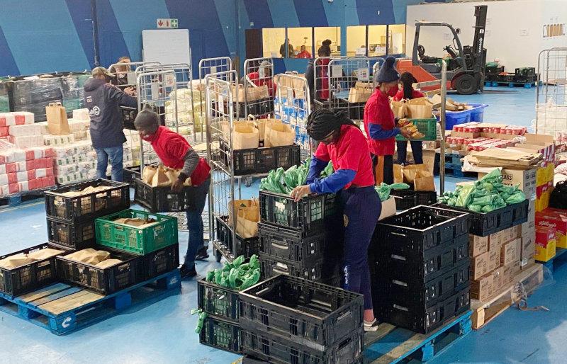 Employees preparing orders at Yebo Fresh's warehouse.