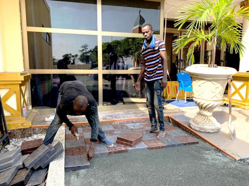 Installation of plastic bricks/ tiles.