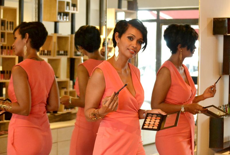 Dominique Raya holding an eye palette and brush in her make up studio in Rose-Hill, Mauritius.