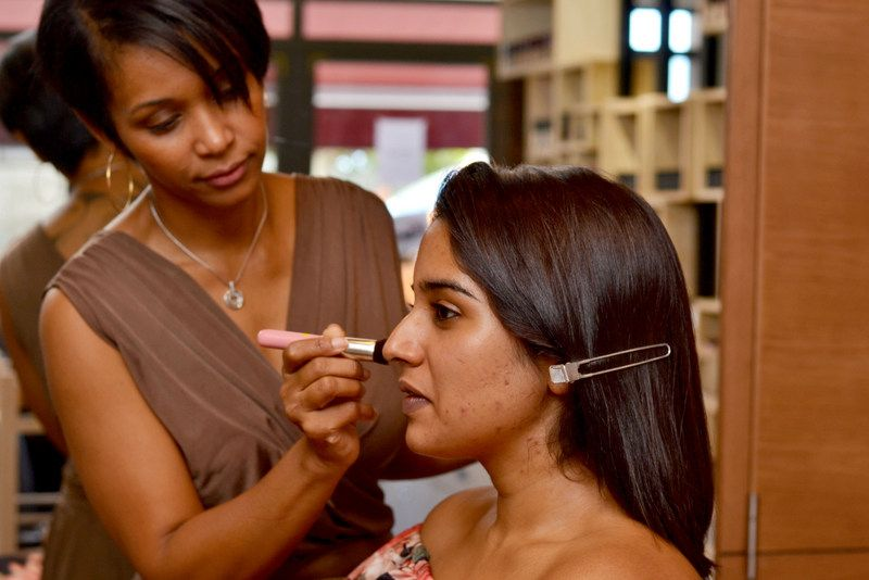 Dominique Raya makes up the face of a client in her make-up studio in Rose-Hill, Mauritius.